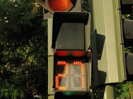 Pedestrian light with amber light informing pedestrians how much time they have left to cross the road