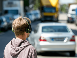 Man walking with headset on the street